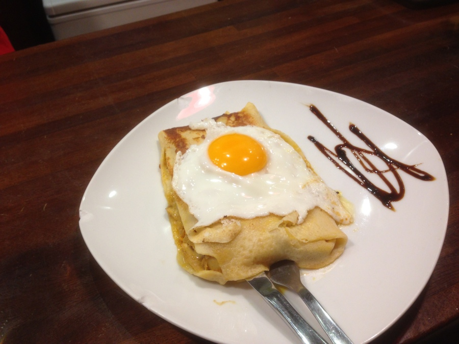 Filloa filled with chocolate and topped with an egg.
